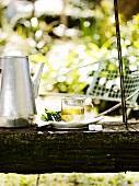 Mint tea with sugar cubes in a garden