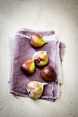 Figs on a purple cloth