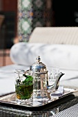 Tray of mint tea in pot and glasses