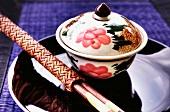 A rice bowl with chopsticks (China)