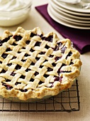 Berry Pie with Lattice Crust on a Cooling Rack