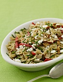 Bowtie Pasta Salad with Feta Cheese, Red Bell Peppers and Walnuts; In a Serving Bowl