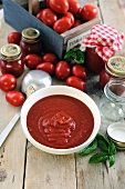 Freshly made tomato sauce in a bowl and in jars