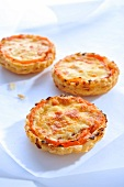 Twice-baked tomato and cheese tartlets