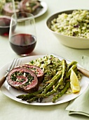 Slices of Stuffed Rolled Beef Served with Asparagus and Rice; Red Wine