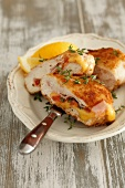Stuffed chicken breast with ham, cheese, tomatoes and thyme