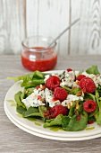 Spinach salad with raspberries and gorgonzola cheese