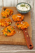 Carrot and spring onion cakes with a yogurt dip