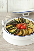Aubergine bake with courgettes and tomatoes