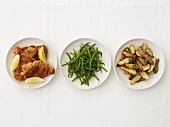 Fried Chicken, Green Beans and Potatoes on Separate Plates