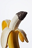 A Partially Peeled Banana with Chia Seeds