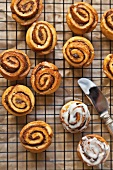Cinnamon Buns on a Cooling Rack with Vanilla Icing