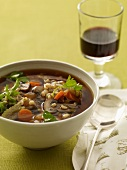 Bowl of Beef and Barley Soup; Glass of Red Wine