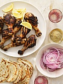 Grilled Drumsticks with Pita Bread and Red Onion