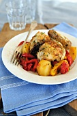 Pan fried chicken pieces with sweet and sour bell peppers and potatoes