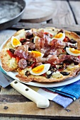 Pane carasau condito (unleavened bread with bacon, egg and mushrooms)