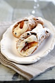 Cannoli (deep fried pastry rolls filled with ricotta cream, Italy)