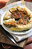 Swiss chard and ricotta puff pastry savoury tart topped with parmesan cheese