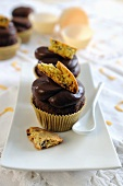 Chocolate fudge cupcakes with chocolate frosting and chocolate chip cookie topping