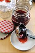 Making strawberry jam 3 – ladling into jars