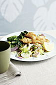 Fish with potatoes and lentil salad