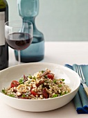 Calamari and Barley Salad in a White Bowl with Red Wine
