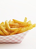 Crinkle Cut French Fries in a Cardboard Take-Out Container; White Background