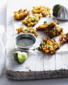 Thai corn fritters on wooden board