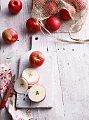 Sliced apples on wooden board