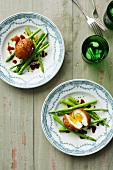 Plates of fried eggs and asparagus