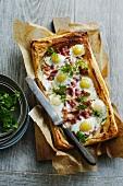Bacon egg tart on wooden table