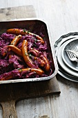 Dish of purple cabbage and frankfurters
