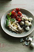 Plate of quail eggs dukkah with tomatoes