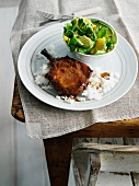 Plate of pork chop, rice and salad