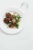 Plate of lamb cutlets and green beans