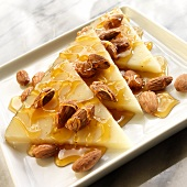 Thin Wedges of Manchego Cheese with Roasted Almonds and Honey