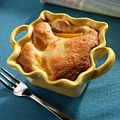 Individual Peach Cobbler in a Yellow Baking Dish