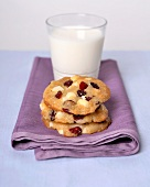 Macadamia nut and cranberry cookies and a glass of milk