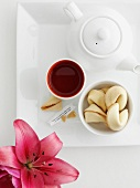 Tray of fortune cookies, sauce and tea