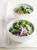 Bowls of noodles and veggies