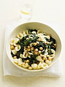 Bowl of pasta with spinach and beans