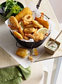 Bowl of onion rings and fried prawns