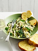 Bowl of pasta with peas and toast