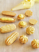 Biscuits with vanilla cream on baking paper