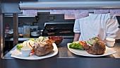 Plates of food in restaurant kitchen
