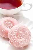 Pink Donuts with a Cup of Tea