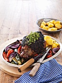 Mediterranean roast lamb with vegetables and potatoes