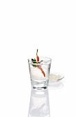 A chilli pepper in a shot glass