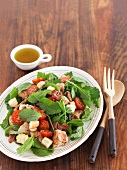 Spinach salad with chicken, bacon and a honey and citrus dressing