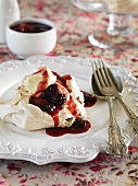 Meringues with brown sugar and blackberry sauce